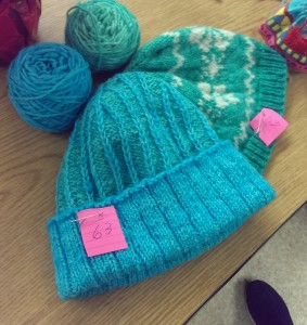 A pair of green and blue hats.