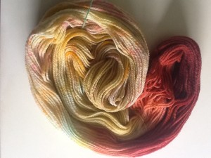 Targhee two-ply, dyed with a jawbreaker, tic-tacs and sprinkles, then gradient dyed with red-to-blue Kool-aid.