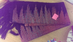 Saori scarf woven on rigid heddle loom, using blue and red dyes for a purple effect.