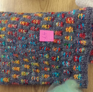 Knit cowl. The charcoal grey tones down the vibrant colors.