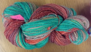 """Sunset Colors"" yarn. The turquoise shade is great."