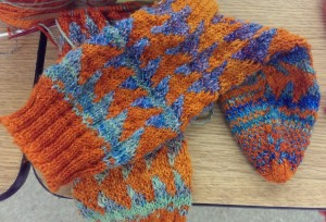 Knit socks, blue and orange. The heathered blue tones down the orange.